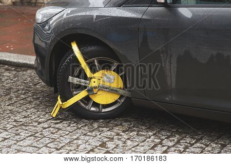 Car was locked with yellow clamped vehicle, wheel lock. Parking on forbidden place in the old town.
