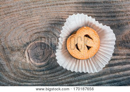 Danish butter cookies on wooden background. Close up