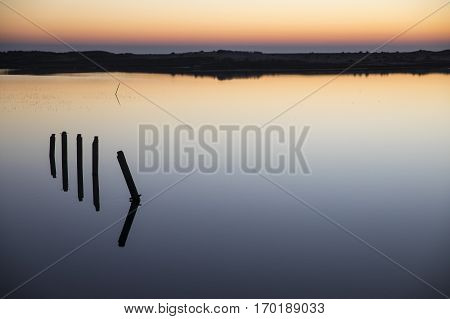 landscape at sunset with reflection in still water over nature reserve Casse de la Belle Henriette Vendee France