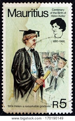 MAURITIUS - CIRCA 1980: a stamp printed in Mauritius shows Helen Keller graduating college blind and deaf writer and lecturer circa 1980