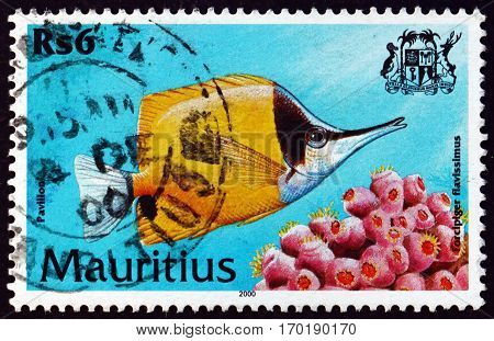 MAURITIUS - CIRCA 2000: a stamp printed in Mauritius shows Yellow longnose butterflyfish forcipiger flavissimus is a species of marine tropical fish circa 2000