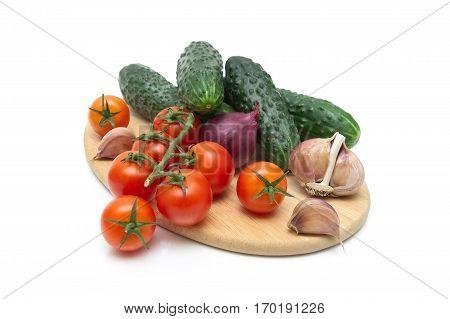 cherry tomatoes cucumber and garlic isolated on white background. horizontal photo.