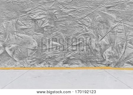 The texture of the ice surface with a fragment of the hockey boards. Texture background