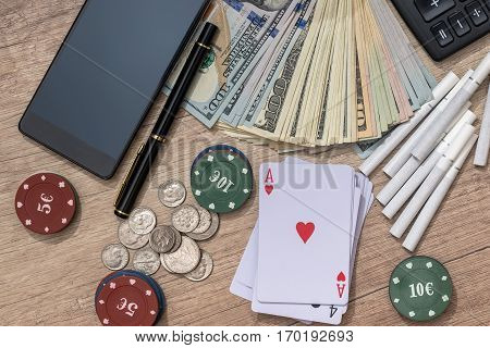 poker combination - play card, money, phone, poker chips