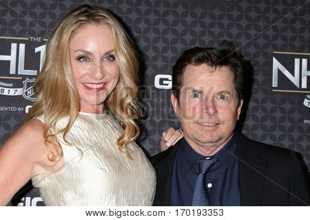 LOS ANGELES - JAN 27:  Tracy Pollan, Michael J. Fox at the NHL 100 Gala at Microsoft Theater on January 27, 2017 in Los Angeles, CA