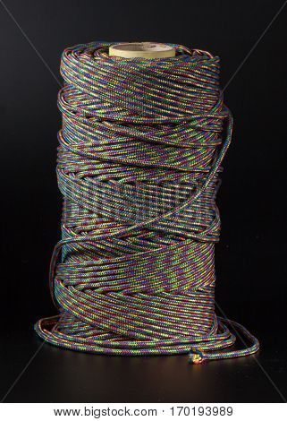 coil of rope on a black background colored rope