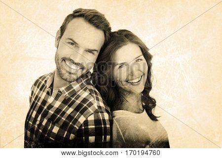Close up of happy young couple standing back to back against grey background