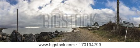 Panoramic view of the coastline and dike protecting the village of l'Aiguillon sur Mer Vendee France