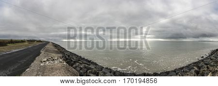 Panoramic view of the dyke proctecting the village of l'Aiguillon sur Mer Vendee France