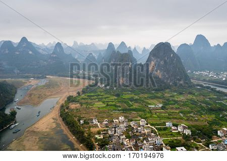 The view from laozhai shan in Yangshuo, Guangxi, China.  The view of karst mountains, hills, the village in one of China's most popular tourist destinations.