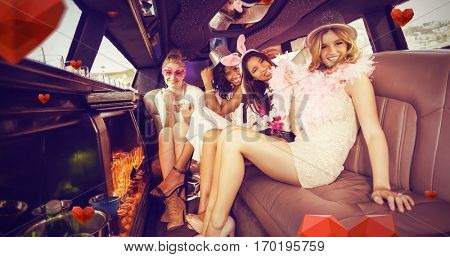 Portrait of female friends in limousine against hearts