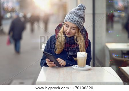 Young Woman Sitting Enjoying A Drink Outdoors