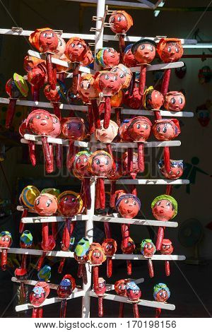 Maracas With Faces On A Souvenir Shop Of Santiago