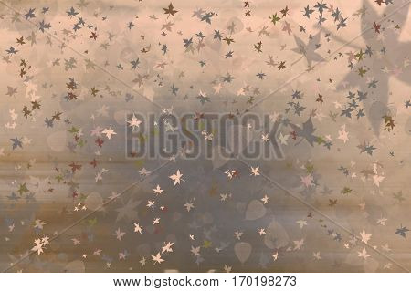 Wintery cold coloured background with leaves falling