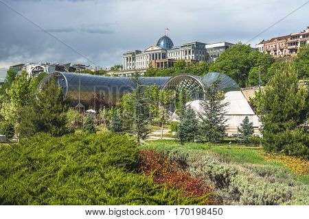 Tbilisi, Georgia - May 5, 2016: two sculptural volumes for a New Cultural Center (foreground) and the Presidential Palace (background) in Tbilisi, Georgia on May 5, 2016