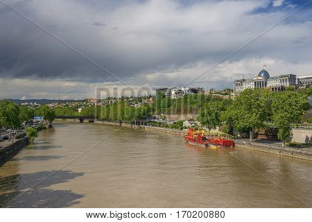 view of the river Kura (Mtkvari) and complex of residence of Georgian President in Tbilisi, Georgia