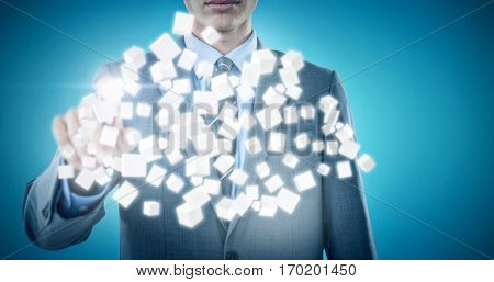 Midsection of well dressed businessman pointing against blue vignette background 3d