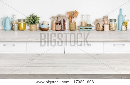 Wooden table over blurred kitchen furniture shelf with food ingredients