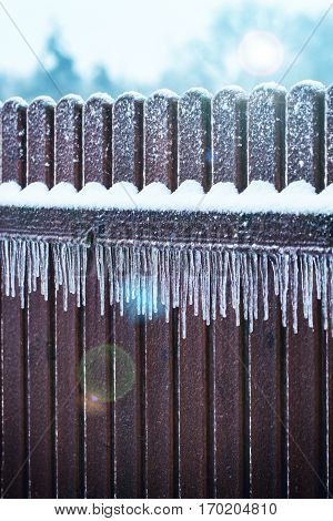 Цinter Icicles on fence after freezing rain