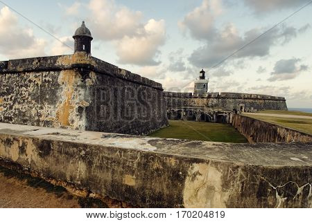 View of El Morro Fort with sunset sky San Juan Puerto Rico