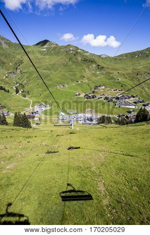 alpine landscape in summer viewed from the chair lift Alps mountain massif Cantons Vaud and Valais Swiss Alps Switzerland