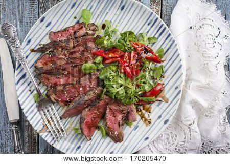 Barbecue Tagliata with Corn Salad and Chili on Plate