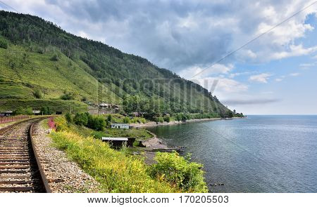 Railroad and sparsely populated village on shore of Lake Baikal. Maritui. Irkutsk region. Russia