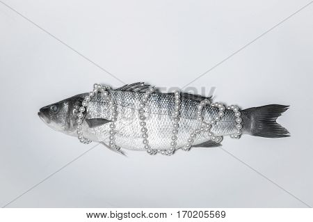 Surrealistic isolated fish with a pearl necklace Magritte inspired