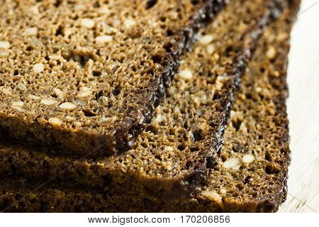 Stack of slices of wholemeal rye bread with seeds, close up