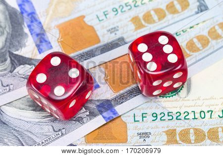 the U.S. dollars and dice on white background