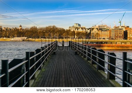 view on the small pier on the river on a sunny day pier in the city