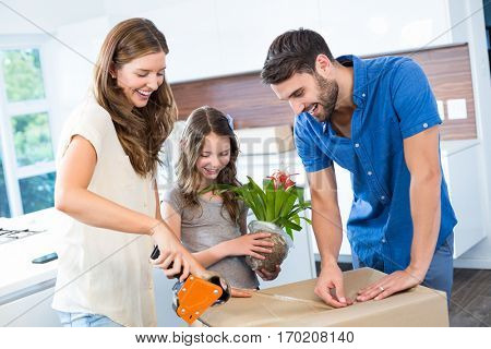 Happy family packing box at home