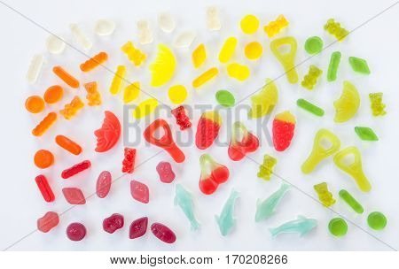 Variety of colorful soft candies arranged in a rainbow