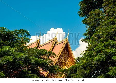 Beautiful roof, clouds and sky next to the Great Stupa in Vientiane, Laos