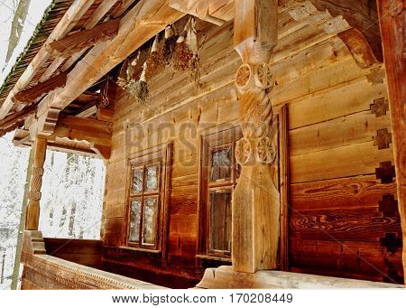 Carving Porch Of An Old Wooden Village Hut