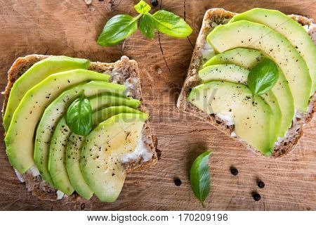Sandwich with avocado slices and basil