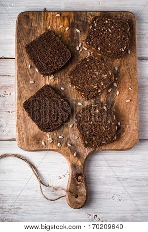 Slices of rye bread on a cutting board vertical