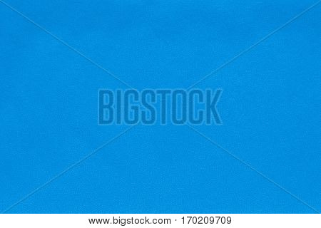 background and abstract spotty texture of textile material or fabric of pale blue color