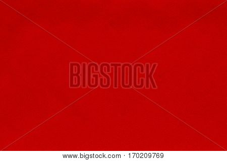 background and abstract spotty texture of textile material or fabric of red color