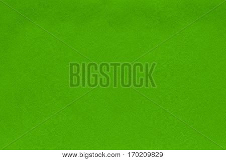 background and abstract spotty texture of textile material or fabric of green color
