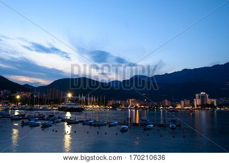 Night Panorama of Budva City and the Dock with Lot of Boats. Montenegro, Balkans, Adriatic sea, Europe.