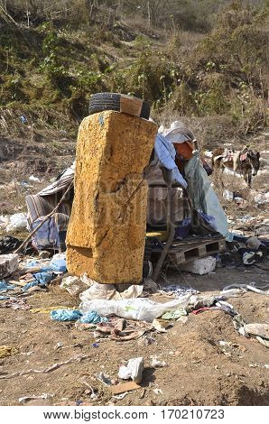A shelter, home, and residence of a dump dweller in a city landfill in Mexico