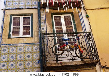 Little bicycle hanging in a balcony of a typical old Lisbon apartment