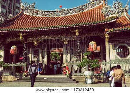 Taipei - December 2016: People in front of Lungshan Temple.