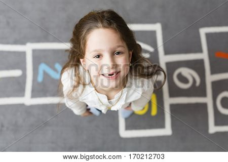 Six years preschool girl looking forward for school