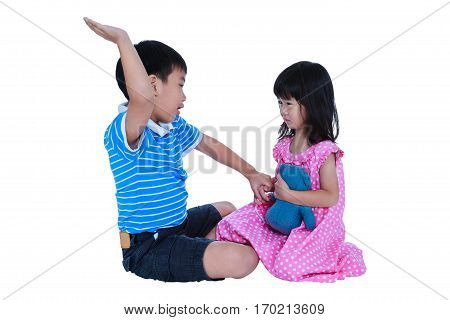 Fighting and quarreling conflict of child. Sad asian girl has problem between brother. Sibling wrest with teddy bear. Relationships difficulties in family concept. Isolated on white background. Studio shot.