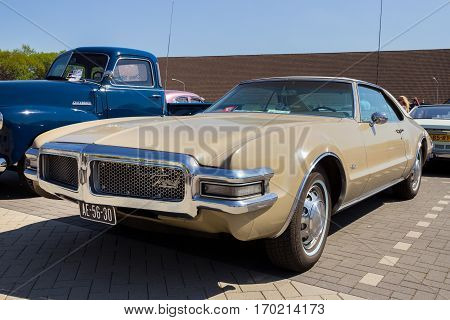 DEN BOSCH THE NETHERLANDS - MAY 8 2016: Classic 1968 Oldsmobile Toronado car on the parking lot at the Rock Around The Jukebox event.