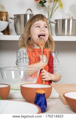 Funny Child Cooking Licking Wooden Spoon