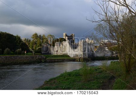 Ireland's Desmond Castle ruins with storm clouds swirling.