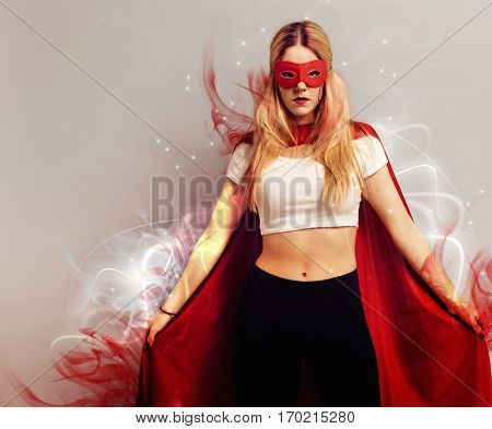 Portrait of a young woman dressed as superhero